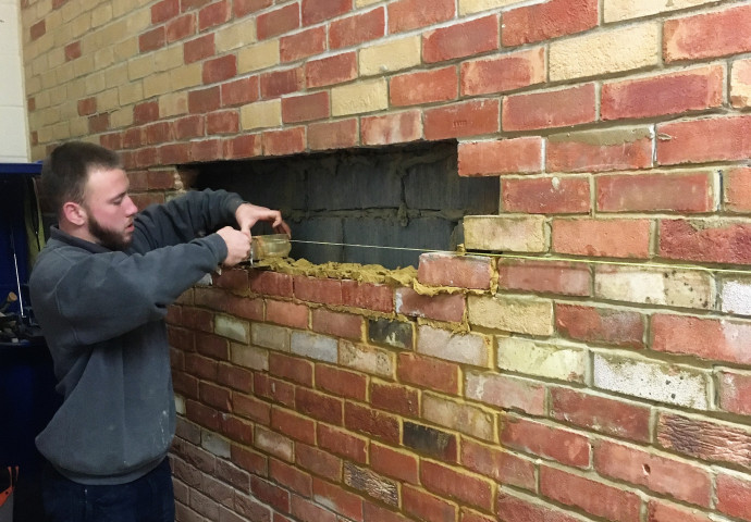 Replacing removed brickwork using the original bricks.